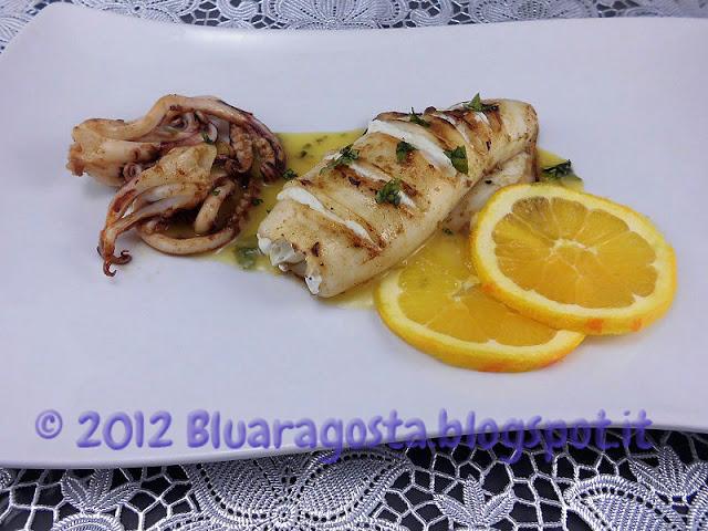 Cannolo di calamaro ripieno di ricotta con salsa all'arancia