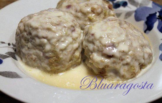 Canederli con verza brasata, speck e fontina in crema di parmigiano